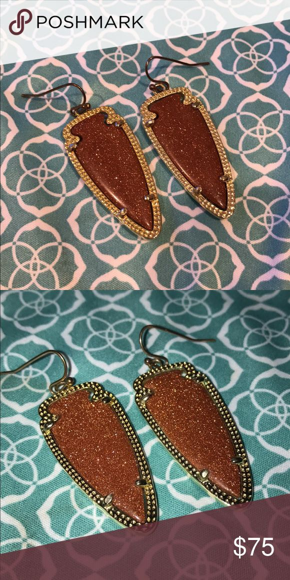 Kendra Scott goldstone Sky's Amazingly sparkly goldstone Sky earrings. The hooks are tarnished but Kendra Scott stores will give you free replacement hooks. The frames and stones are in great used condition. This style and color are discontinued. Price is firm. Cheaper on M or P. Kendra Scott Jewelry Earrings