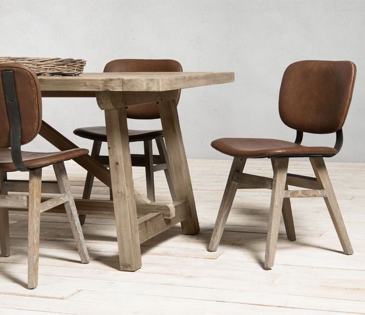 Dont you just love how trendy and modern our Tames vintage leather chair is!
