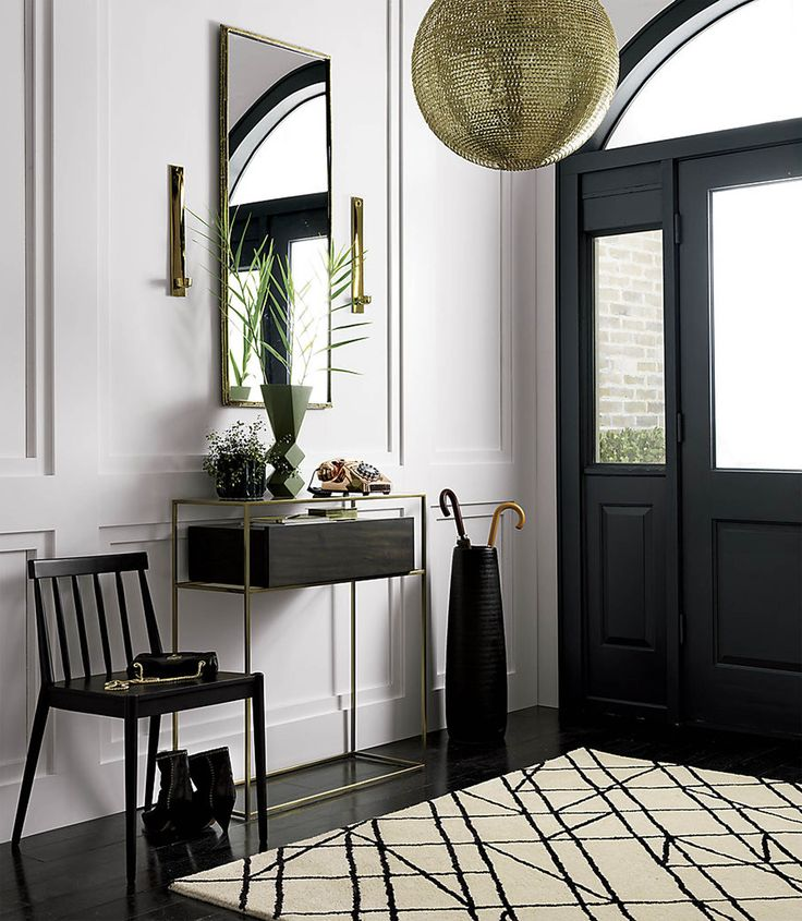 A bold entryway featuring furniture from CB2 / Victoria McGinley