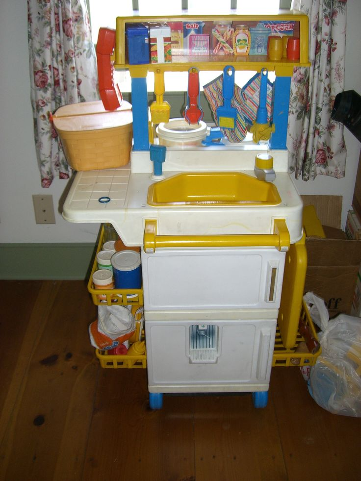 Old Fisher Price Kitchen. looks almost exactly like how I would have had mine set up when i was little.