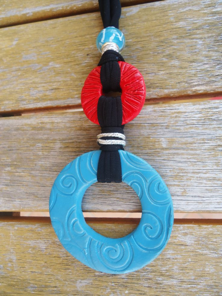 Turquoise, black and red.... handmade with clay and with love...