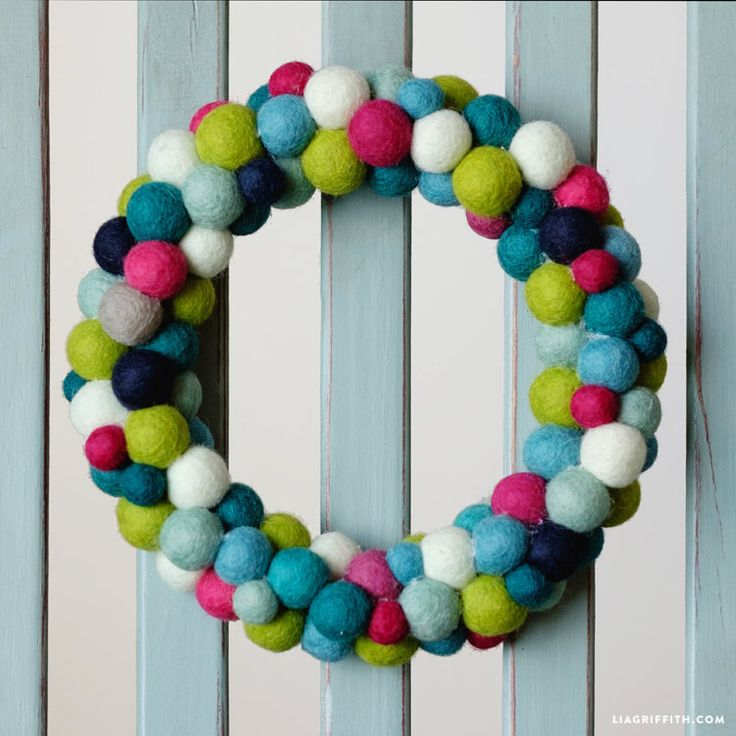 Follow our instructions to make a simple felt ball wreath for Christmas. Grab your hot glue gun, an embroidery hoop & felt balls for this 15 minute project