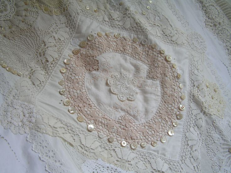 old linen, old lace, vintage buttons on a tablecloth