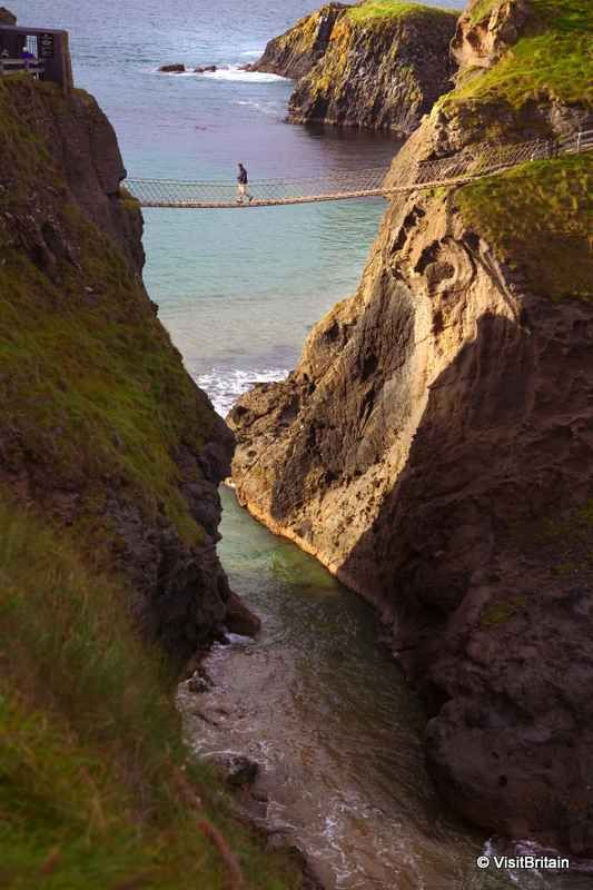 Carrick-a-Rede Rope Bridge in Ballintoy in Northern Ireland (UK), unrivalled coastal scenery.  Carrick-a-Rede Rope Bridge is a famous suspension bridge that links the mainland to the tiny island of Carrick-a-rede. It spans 20 metres (66 ft) above a 30 metres (98 ft) deep chasm.