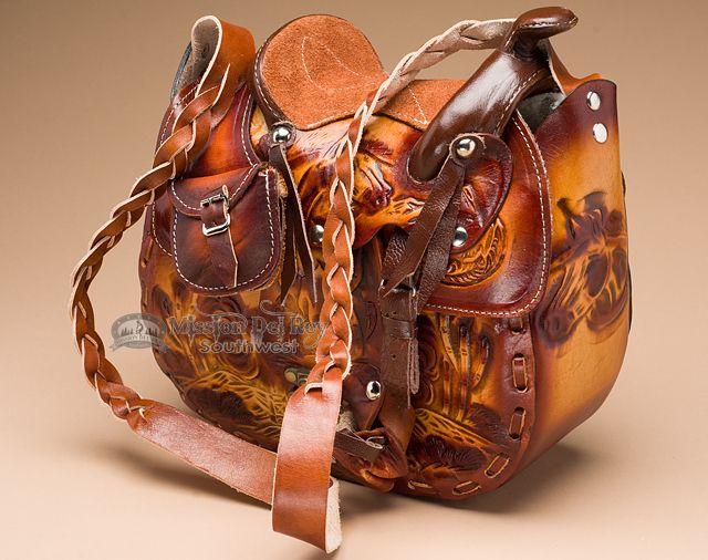 This is a beautiful southwest or western leather saddle style purse made with fancy leather embossed sides for a hand tooled look. The saddle purse is an amazing work of art, both unique and beautiful