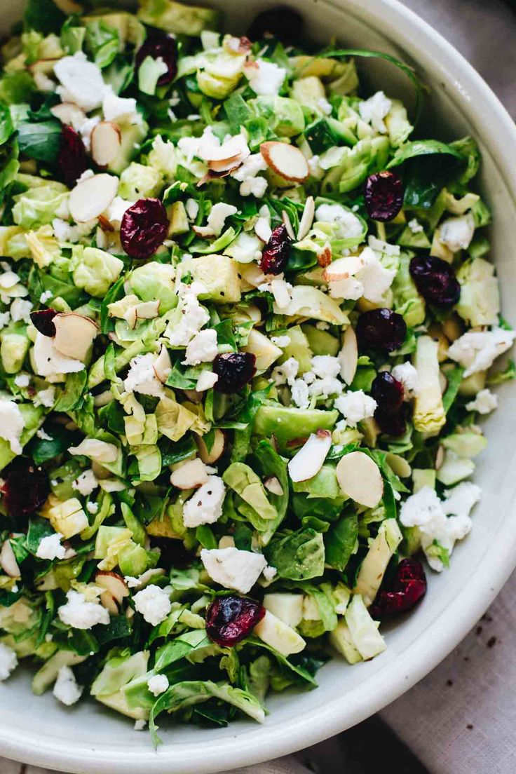 Shaved Brussels Sprout Salad w/ Cranberries! Vegetarian, gluten free, and easy to make. This salad is such a hit! Recipe is on Jar Of Lemons.