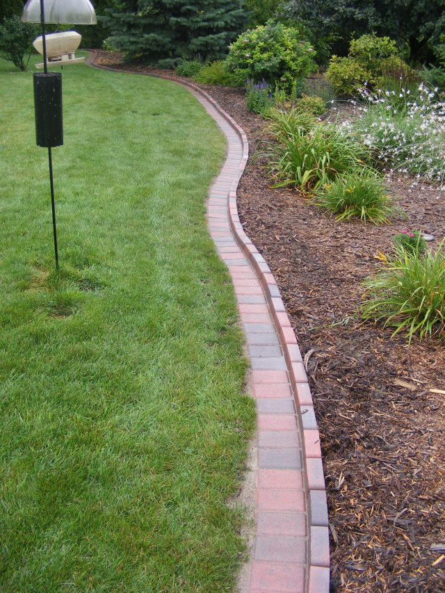 Garden Brick Edging Ideas this design is perfect for creating a border for a small circular garden the edge is made from pieces of concrete that have been cut into brick sized Brick Garden Edging Ideas Fresh Furniture Idea