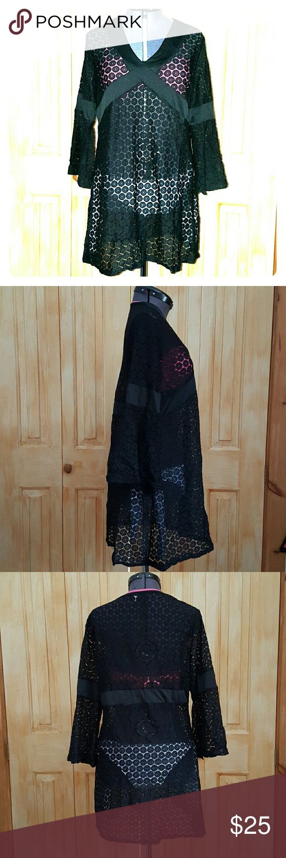 Bell Sleeve Lace Cover Up Beautiful black lace swimsuit v neck cover up with bell sleeves. This is versatile enough that you cou also pair it with legging and a cute cami underneath. Makes it totally worth the $ to be able to wear it 3 seasons instead of just the summer. Mermaid bikini shown underneath also listed. Dress form is set at 34-25-36. The tag says medium, but could easily fit a size larger or smaller. Boutique Swim Coverups