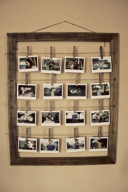 Photo display in a wooden frame with string and clothes pins! Easy to switch out pictures whenever you'd like