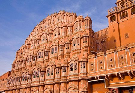 Jaipur, India - One look at the rosy sandstone used for building palaces such as the Hawa Mahal and it's understandable how the capital of Rajasthan become known as the Pink City. This pink sandstone palace has almost 1,000 windows, which allowed royal women to look down on the busy street bazaars without being observed.