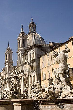 Piazza Navona - Water fountains and sculptures in Piazza Navona with historical buildings in background, Rome, Italy. Photo taken on: June 27th, 2010 © Morgan Capasso