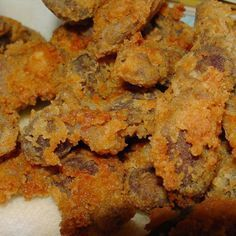 I grew up liking chicken gizzards so I occasionally have a yen for them. I like them tender, but fried golden brown and crispy. It is hard to get those two descriptions at the same time. If you like them too, try my method and see if you can resist eating more than you should. Yum