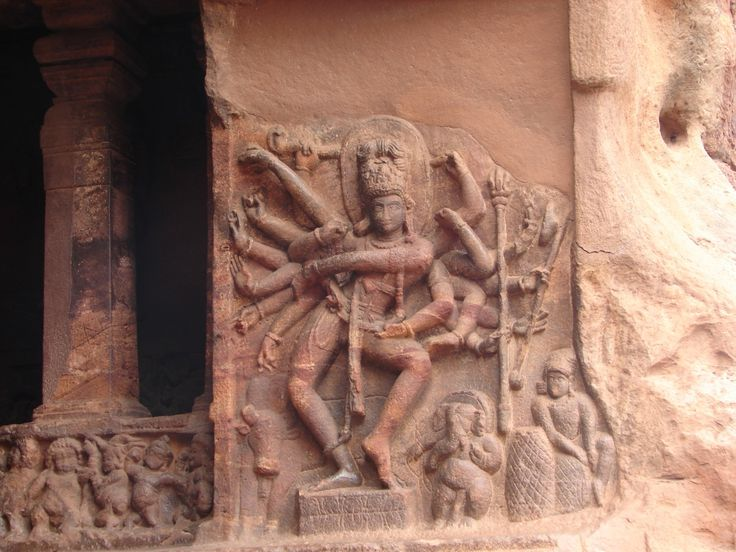 Ancient Indian wall relief of dancing Shiva at cave Temple No.1 in Badami. The cave temple was built around 578 CE, during the reign of the Badami Chalukya dynasty. Photo courtesy & taken by Dineshkannambadi,  Badami, Karnataka, India