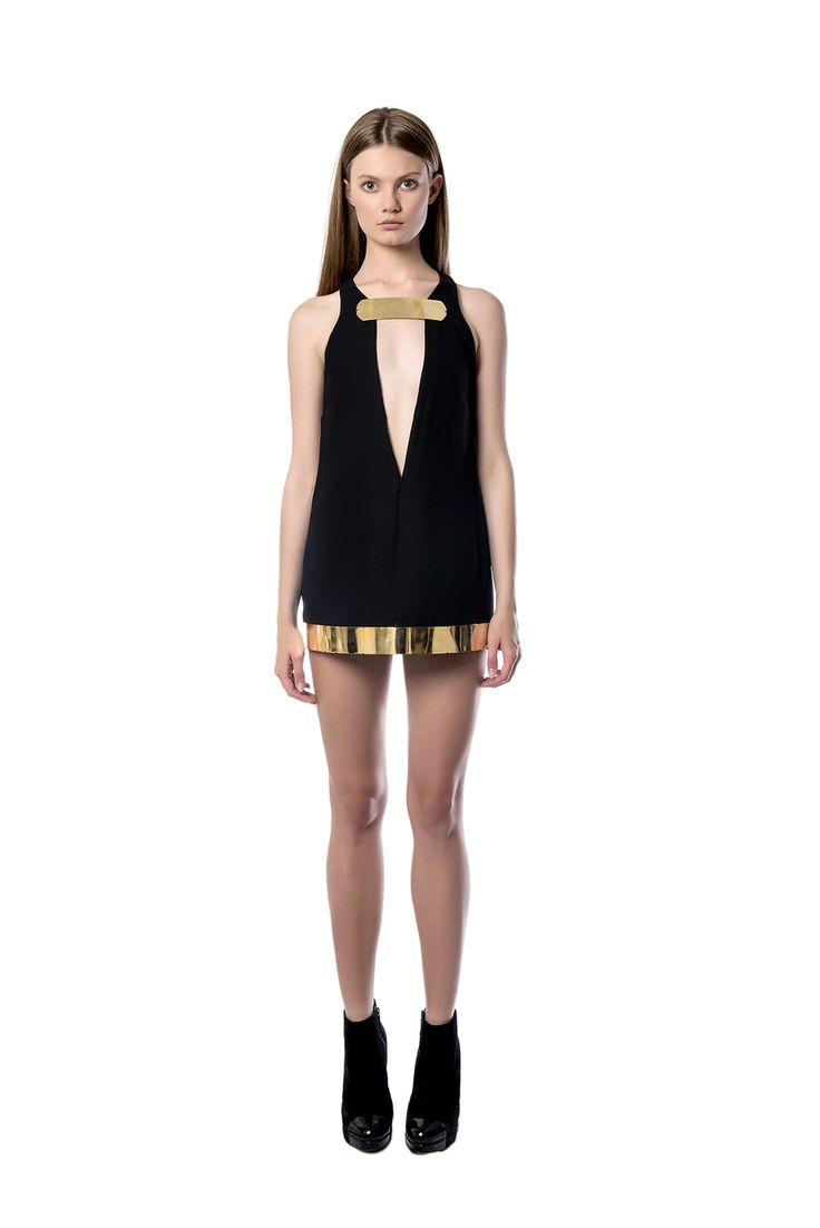 Mini black dress detailed with metallic accessories  This mini black dress is the perfect pick for an outstanding look. Crafted from light crepe, has a burnished gold plunging neckline to highlight your décolletage and is detailed with metallic elements at the finish of the hem. Keep it in focus with swept – back hair.