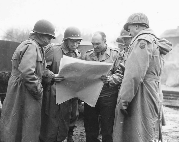 Omar Bradley George Patton and Manton Eddy being shown a map by one of Pattons Armored Battalion Commanders during a tour near Metz France 13 November 1944.