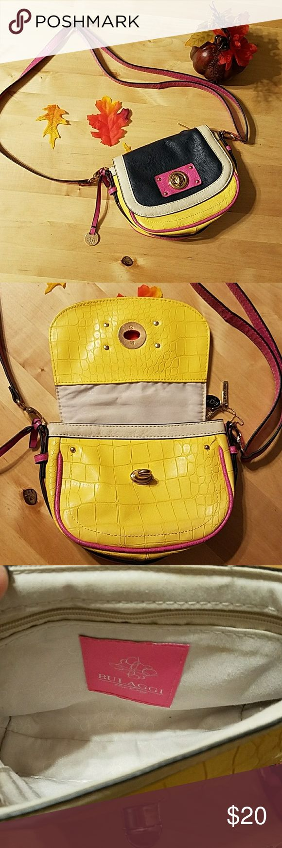 """Bulaggi crossbody Bulaggi crossbody, great colors. 7""""×6""""×2"""" with 24"""" adjustable drop strap. This has a few scuffs from being loved but still has so much to offer. Bulaggi Bags Crossbody Bags"""