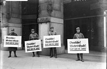 """At 10 a.m. on April 1, 1933, members of the Sturmabteilung moved into place all over Germany, positioning themselves outside Jewish-owned businesses to deter customers. These stormtroopers are outside Israel's Department Store in Berlin. The signs read: """"Germans! Defend yourselves! Don't buy from Jews."""" (""""Deutsche! Wehrt Euch! Kauft nicht bei Juden!"""") The store was ransacked during Kristallnacht in 1938, then handed over to a non-Jewish family."""