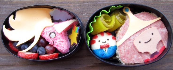 Adventure Time Bento - Pink rice, cheese and fruit Lady Rainicorn. Babybel cheese Peppermint Butler. Salami, bologna and cheese Princess Bubblegum.