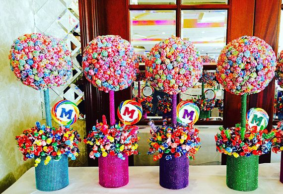 Make your special occasion even sweeter! This gigantic Lollipop Centerpiece is sure to make a lasting impression and a statement for your guests. This is a perfect size for a 6-8 top table and can be made in a variety of colors with a monogram, name or theme on it to match your event. THIS IS CUSTOM MADE FOR YOU! dont be afraid to ask we will try to accommodate you! This tree stands 26 inches tall, holds app 525 lollipops and weighs 11 pounds. Flowers are pretty but they dont last long, this…