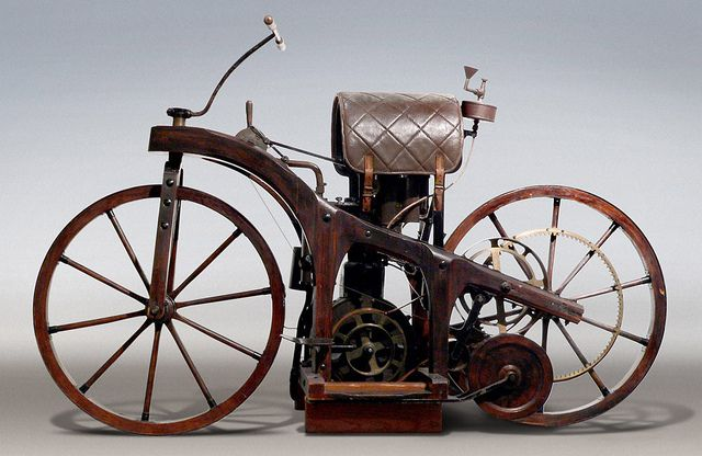 "clademenswear: "" ""In November 1885, Gottlieb Daimler installed a smaller version of an engine in a wooden bicycle, creating the first motorcycle (Patent 36-423impff & Sohn ""Vehicle with gas or petroleum drive machine""). It was named the Reitwagen..."