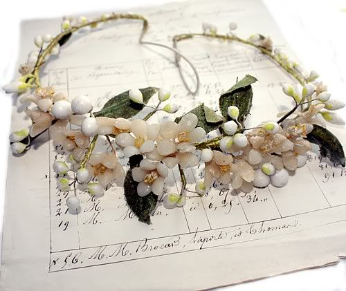 """Antique French Wax Orange Blossom Wedding Tiara with sweet flowers and wax dipped buds. Since Victorian times, Orange Blossoms were worn as a Bride's Head Crown as symbols of happiness and fertility ~ because the orange tree blooms and bears fruit at the same time. ca early 1900's.     This Bridal Headpiece or Tiara has a multitude of Wax Buds on Silkwrapped Wire. The headpiece measures about 7"""" x 8"""" x 2~1/2"""" high, it still has the original elastic"""