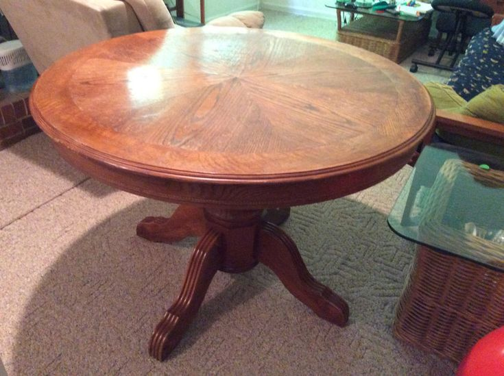 used oak pedestalstyle round dining table  round
