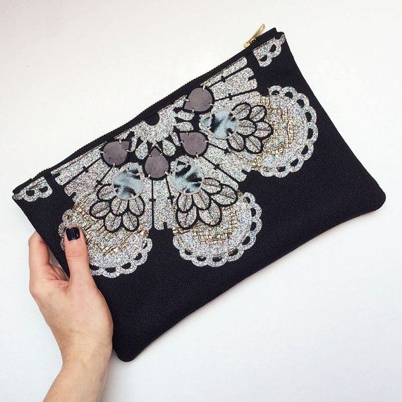 EMBELLISHED STATEMENT CLUTCH in black, gold and silver glitter by dakota rae dust. This LUXURY EVENING BAG has been made an extremely high standard, hand finished and created using high quality materials and components. The front and back panel have been backed to give a firm, padded feel.