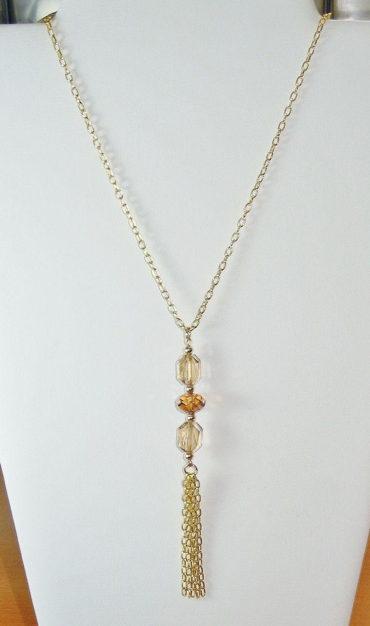 A personal favorite from my Etsy shop https://www.etsy.com/listing/263859569/swarovski-crystal-beaded-tassel-pendant