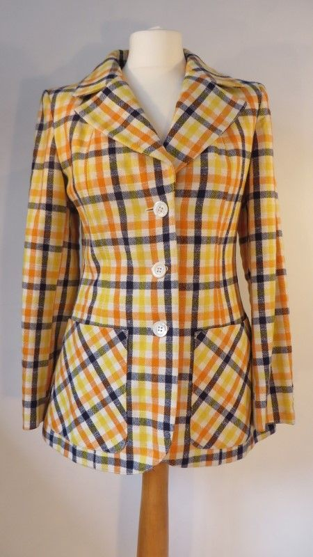Vintage fantastic checked jacket, 10.   Fantastic Italian checked wool mix jacket in cream, navy, orange & yellow. Full lined with pearlised buttons which also feature on the cuffs. A 'half belt' on the back at the waist. Hip pockets. This one is a show stopper! :-)   Size: 10 Measurements: B: 34, W: 32, H: 39, L: 27, S-S:16, Sleeve (underarm to cuff): 17 Label: Kettermarks Decade: 1970 Material: Est. wool / linen mix Cleaning instructions: Dry clean