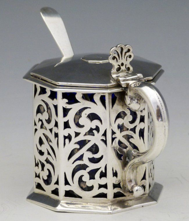 Victorian silver mustard pot, London 1844, with pierced sides, together with a Glasgow silver spoon and blue glass liner.