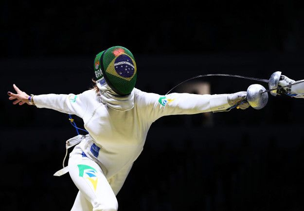 Fencing requires agility on your feet and tons of leg strength, because you're constantly in a squatting position. Olympic fencers typically train between four and seven hours per day, five to six days a week. | 19 Photos That Prove Fencing Is Metal As Hell