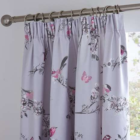 Featuring a bird and floral print in shades of grey and pink on a grey background, these pencil pleat curtains are crafted from a durable polycotton blend and a...