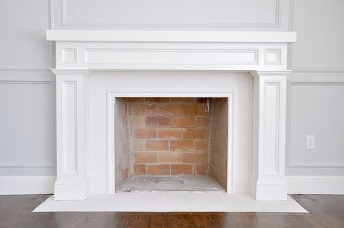 chair rail tile on the inside mouth of the fireplace