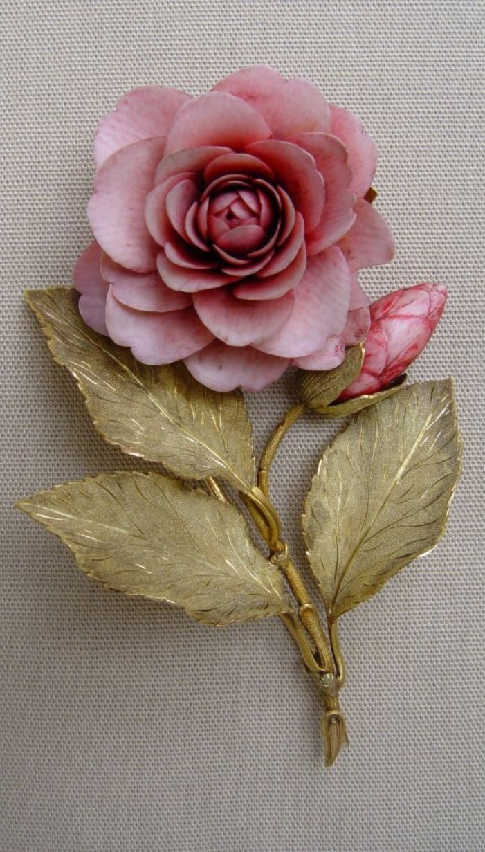 A Victorian gold and ivory brooch, English, circa 1860. Chased gold brooch in the form of a camellia with the flowers of finely carved and tinted ivory. The leaves are green gold. #Victorian