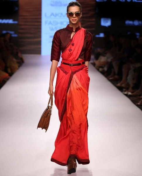 Like the added red belt with loops for a real belt.  Love the blouse.  Hands free saree.