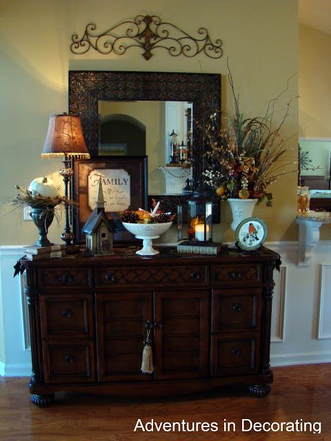 metal piece above mirror over buffet love this for the formal dining room - Dining Room Buffet Decorating Ideas