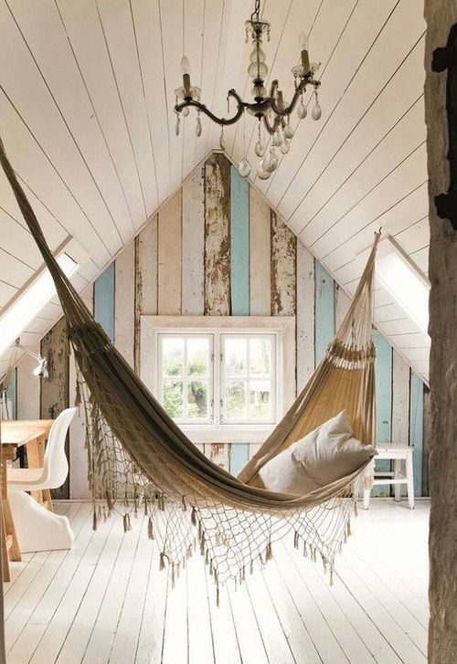 Consider me floored by the coolness of this. Pastel wood, indoor hammock, chandelier, all in an a-frame attic! Really? JC ;)