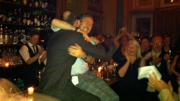Actor Alan Cumming hugs his partner, Grant Shaffer, at the Soho Grand Hotel in New York, where they renewed their wedding vows on Jan. 7, 2012. - Provided courtesy of http://twitpic.com/84jzwp