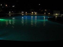 Take a late-night dip in the illuminated swimming pool