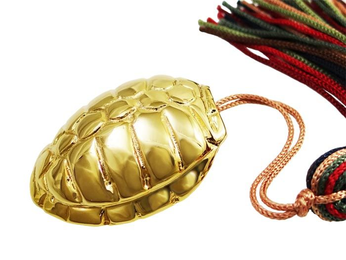 Inspired by the shell of the turtle, we created an extraordinary lucky charm for the year 2015. In the inner side of the carapace, we placed the number 15, in silver 925°. 24K Gold-plated bronze Dimensions: 2,7cm x 3cm