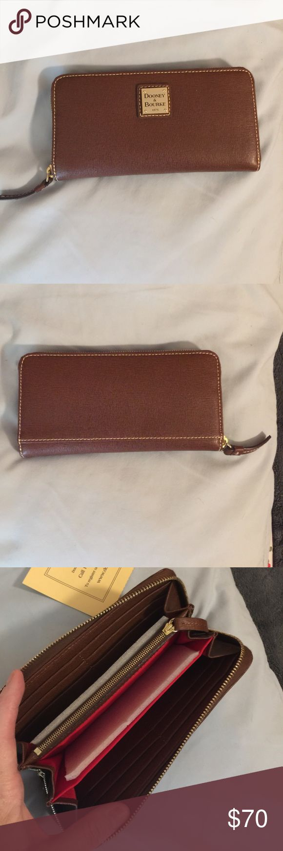 Dooney & Bourke Wallet Dooney & Bourke Large Zip around Wallet. NWT. Color is called Amber, it's a rich brown. Wallet is nwt and in perfect condition. No trades. 8x4x1. Dooney & Bourke Bags Wallets
