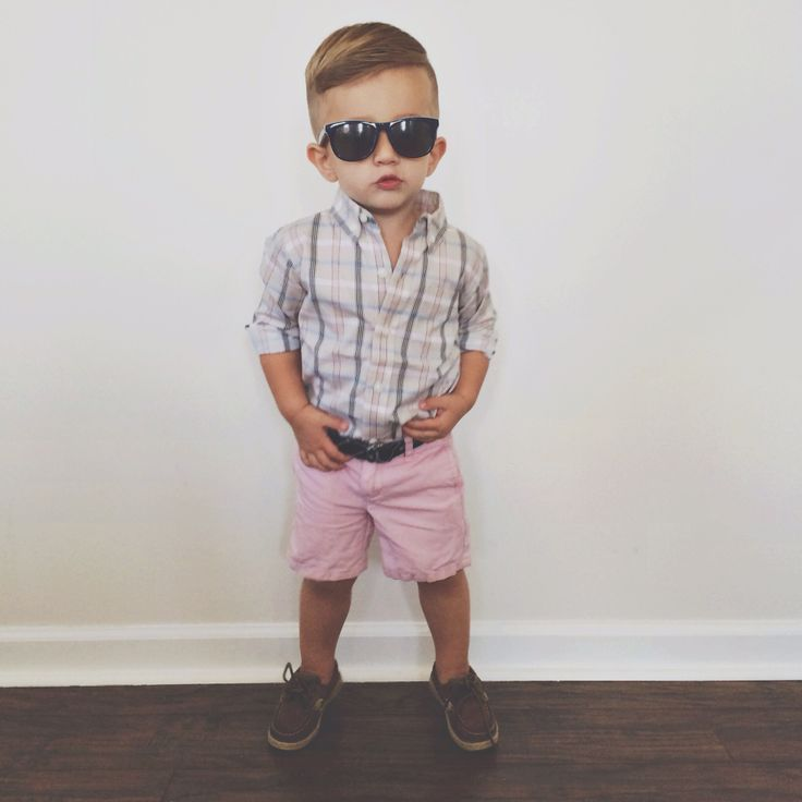 Pink shorts, plaid collared button up, and wayfarers.