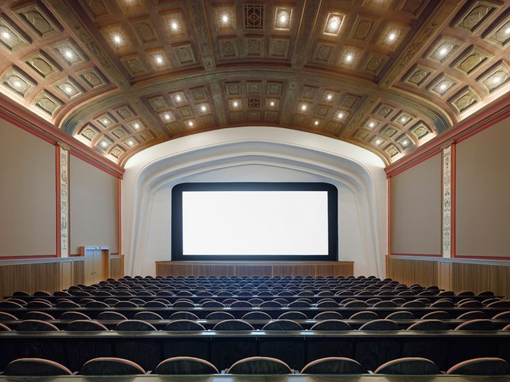one of the oldest functioning cinemas in germany is reinvigorated with 2 new viewing spaces while retaining its sense of history and its iconic golden ceiling.