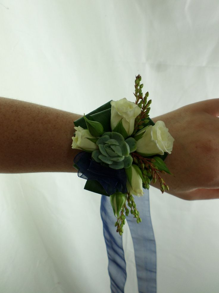 Ball corsage on navy blue ribbon. White roses and succulent. Created by Florist ilene