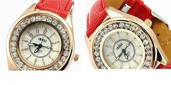 Luxusní hodinky IBELI ve zlaté barvě s kamínky a červeným koženým řemínkem, které jsou