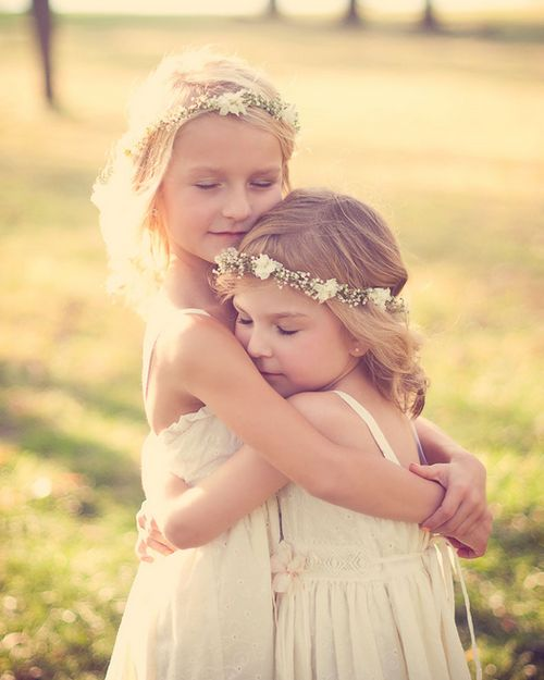 Sisterly love love family cute hug outdoors flowers girls sisters