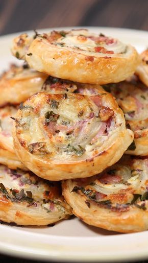 Recipe with video instructions: I mean, do we really need to say anything? Ingredients: 1 pack all butter puff pastry, 5 back bacon rashers, sliced into 1 centimeter strips, 3/4 tub cream cheese, 75 grams cheddar, grated, 1 onion, diced, Handful of parsley, chopped, Salt & pepper to season, 1 egg, beaten