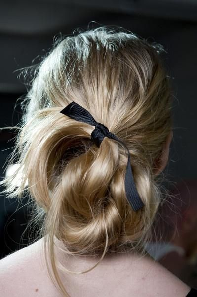 The swoop and tuck tied off with a small ribbon