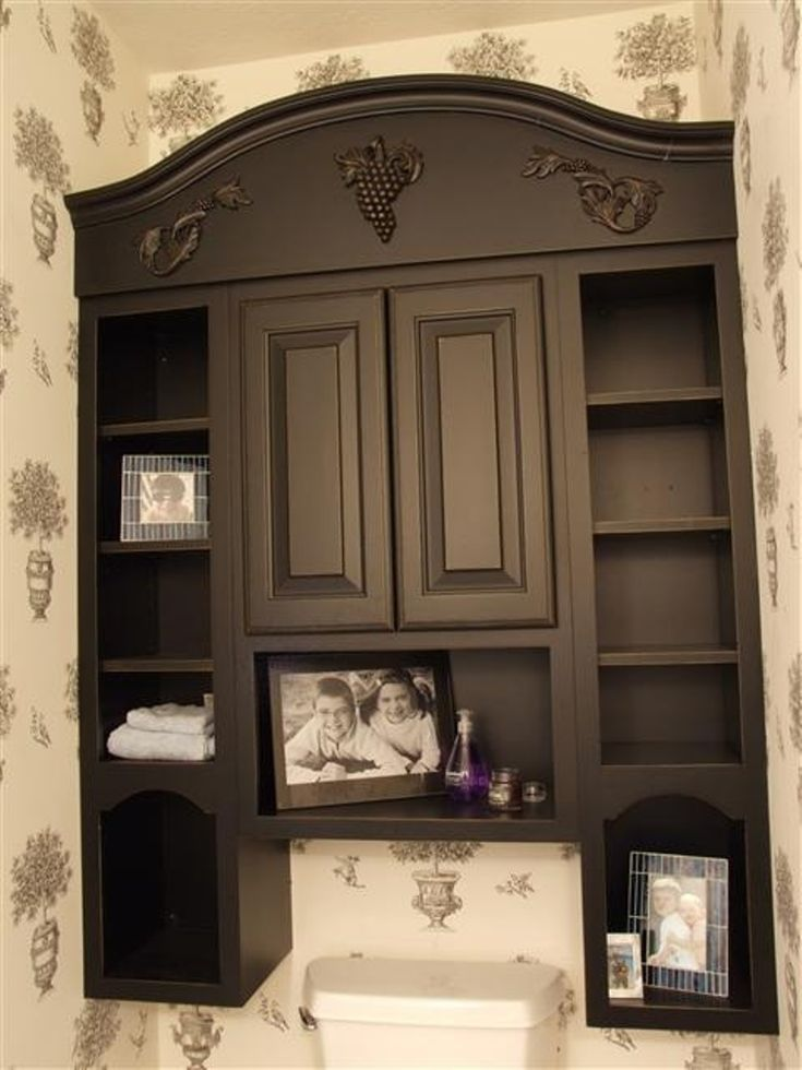 Classic Bathroom With Black Wooden Shelf Bathroom Storage Cabinet Above Toilet And White Soft Towels