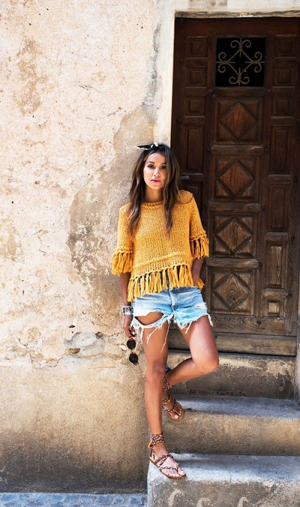 Style Tip: Dress up distressed shorts with a fringed popover top and artisanal sandals.